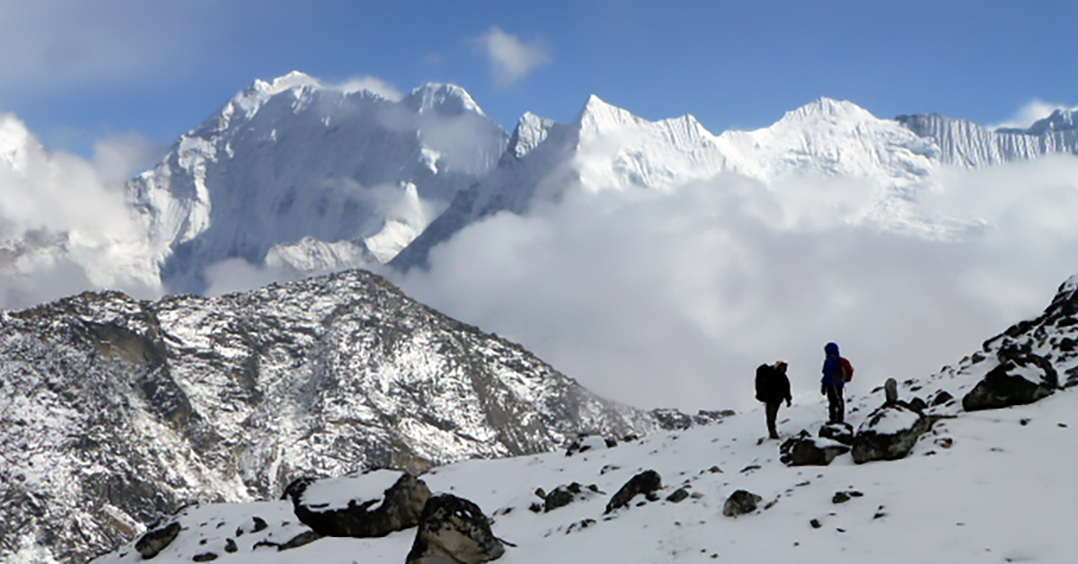 Kami and Janet descending from Kongma La, Buruntse in the background