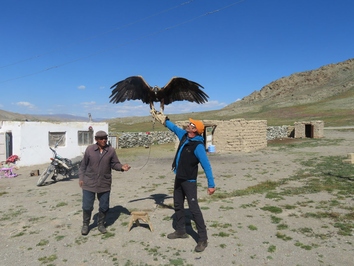Checking out a nomad's hunting eagle | Tom Richardson - Mongolia Expeditions | Outside Staff Blog