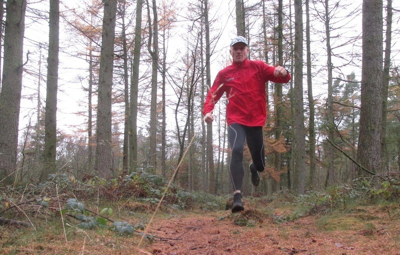 Chris running through local woods